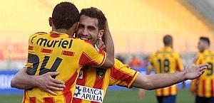 Davide Brivio abbracciato da Muriel dopo il gol al Genoa. Ansa