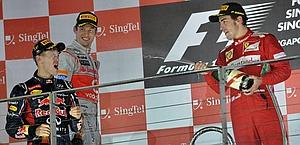 Vettel, Button e Alonso sul podio di Singapore. Afp