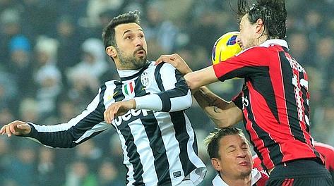 Mirko Vucinic, 29 anni, lotta con Acerbi. Ap
