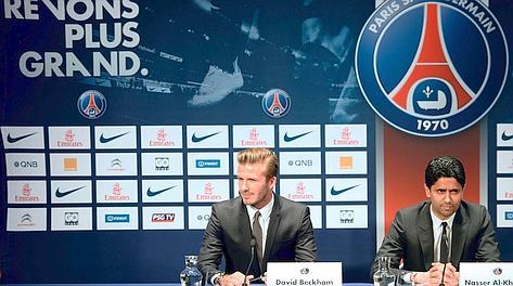 David Beckham con il presidente Nasser Al-Khelaifi. Afp