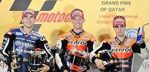 Il podio del Qatar: da sinistra, Lorenzo, Stoner e Pedrosa. Epa