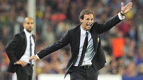 Massimilliano Allegri al Camp Nou; si intravede Pep Guardiola. Afp