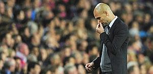 Pep Guardiola esce deluso dal Camp Nou. LaPresse