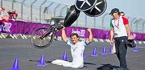 Alex Zanardi celebrating his gold in the time trial. Corbis