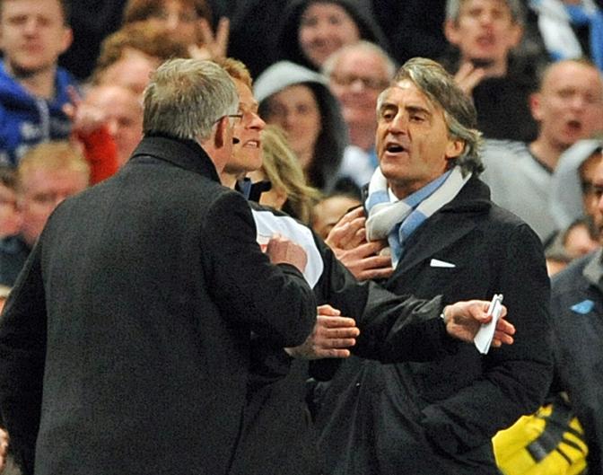 30 aprile 2012. Faccia a faccia con Mancini durante l'incontro con il City. Ansa