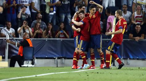 La Spagna esulta dopo il gol di Morata. Afp