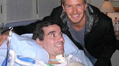 Stefano Borgonovo con David Beckham. Ansa