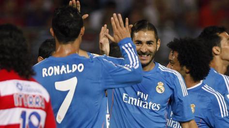 Karim Benzema, 25 anni, esulta con Cristiano Ronaldo. Reuters