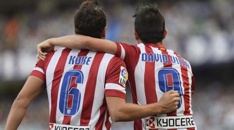 Koke e Villa abbracciati all'Anoeta. Reuters