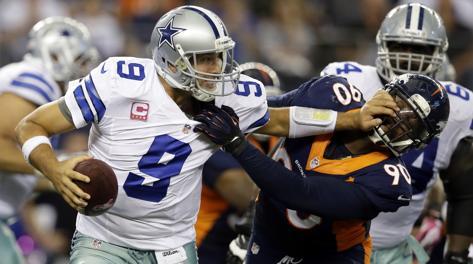 Un'azione del match Dallas Cowboys-Denver Broncos. Ap