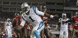 Cam Newton in touch down contro Tampa Bay. Reuters