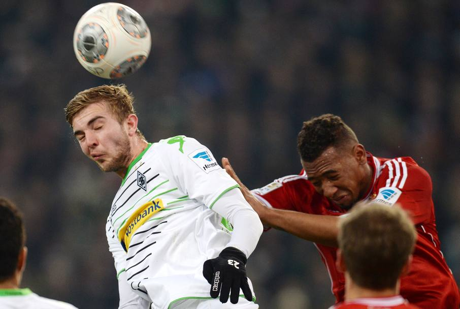 Jerome Boateng spinge Christoph Kramer (Afp)