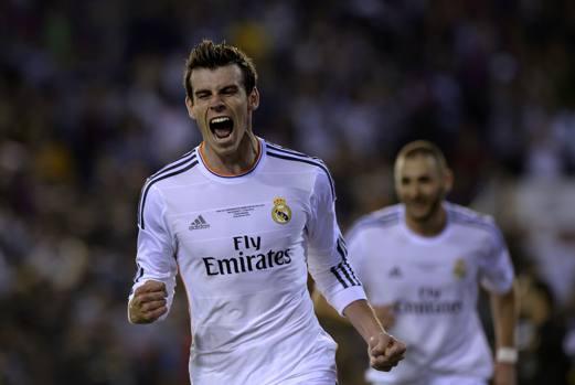 Un gioiello di Bale decide la finale di Coppa del Re. Il Real affonda il Barcellona 2-1, dopo essere passato in vantaggio con Di Maria e aver subito il pareggio di testa di Bartra. Afp