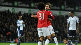 L'abbraccio tra Fellaini e Blind, autori dei due gol dello United. Afp