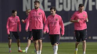 Gerard Piqué e Leo Messi durante un allenamento del Barcellona. Afp