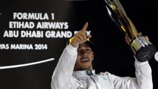 Lewis Hamilton festeggia il mondiale ad Abu Dhabi. Reuters