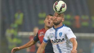 Lorenzo Tonelli in azione durante Genoa-Empoli. Ansa