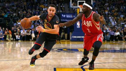 Stephen Curry  (27 anni) e Ty Lawson (28). Afp