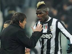 Antonio Conte con Paul Pogba ai tempi della Juve. Ansa