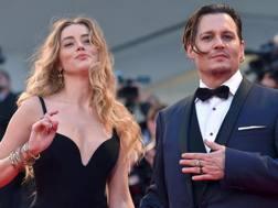 Johnny Depp e Amber Heard al Festival di Venezia. Ansa