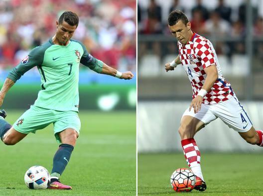 Il portoghese Cristiano Ronaldo contro il croato Ivan Perisic. Afp
