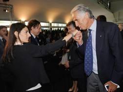 Giovanni Malagò bacia la mano a Virginia Raggi, alla presentazione del logo di Euro2020. Getty