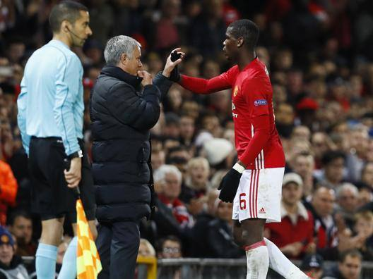 Jose Mourinho e Paul Pogba. Reuters