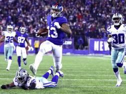 Odell Beckham Jr., dei Giants, corre verso la end zone dei Cowboys. Afp