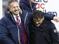 Il tecnico del Toro Sinisa Mihajlovic con l'allenatore del Milan Vincenzo Montella. LaPresse
