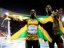 Nesta Carter e Usain Bolt. Getty