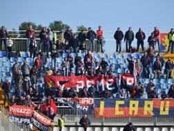 I tifosi del Genoa prima di abbandonare lo stadio. LAPRESSE