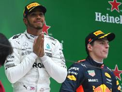 Lewis Hamilton felice con Verstappen sul podio della Cina. Epa