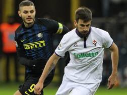 Mauro Icardi e Milan Badelj in azione nel match di andata. Getty