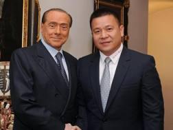Silvio Berlusconi e Yonghong Li. Afp