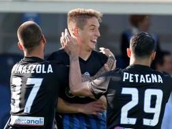 Spinazzola, Conti e Petagna festeggiano il gol del'1-0. Lapresse
