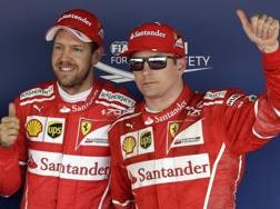Sebastian Vettel con Kimi Raikkonen: prima fila Ferrari in Russia. Ap