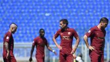 La delusione dei giocatori della Roma. Afp