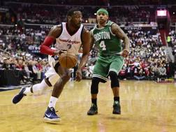 John Wall e Isaiah Thomas. Afp