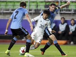 Il numero 20 del Giappone Takefusa Kubo, nella seconda gara del Mondiale Under 20, contro l'Uruguay. Ap