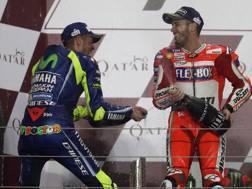 Festa sul podio fra Rossi e Dovizioso. Afp