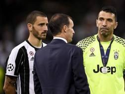 Bonucci, Buffon e Allegri dopo Cardiff. LaPresse