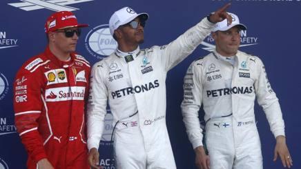 Da sinistra Raikkonen, Hamilton e Bottas. Ap