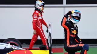 Ricciardo esulta per la vittoria mentre Vettel dietro torna ai box. Getty