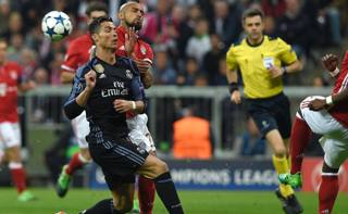 Vidal contro CR7 in Champions. Afp