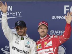Lewis Hamilton e Sebastian Vettel. Epa