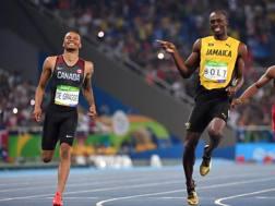 Bolt e De Grasse se la ridono nella semifinale dei 200 a Rio 2016. Afp