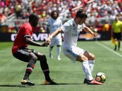 Bale in azione contro il Man Utd. Afp