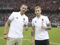Leonardo Bonucci e Lucas Biglia: inseriti nella lista Uefa del Milan, LaPresse