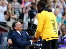 Sebastian Coe, 60 anni, durante la premiazione dei 100 metri con Usain Bolt, 30 LAPRESSE