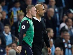 Rooney e Pep Guardiola al termine di Manchester City-Everton.
